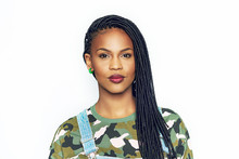 Pretty African Woman With Braided Hair And Makeup