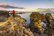 Snaefellsness Peninsula, Iceland. Man Standing Over A Rock Formation Along The Coast.