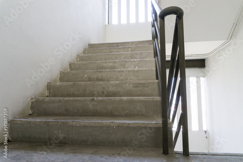 Old staircase with a handrail in a building