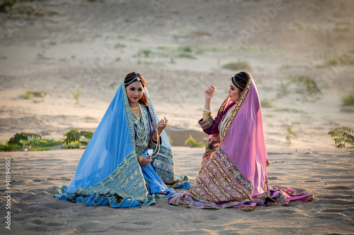 Fotografie, Obraz  Persia or Iran Women's sitting talking joyful and relaxing on sand or Beach