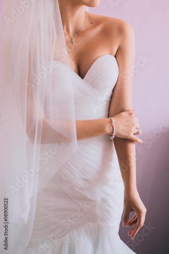 Fototapeta Beautiful bride with fashion wedding hairstyle. Closeup portrait of young gorgeous bride. obraz na płótnie