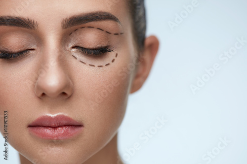 Obraz Plastic Surgery Operation. Woman Face With Black Surgical Lines - fototapety do salonu