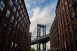 Manhattan Bridge and Brick Buildings in Brooklyn, New York, USA
