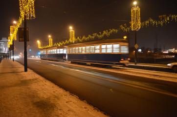 Fototapeta na wymiar Tramwaj zimową nocą w Krakowie/A tram in winter night in Cracow, Lesser Poland, Poland