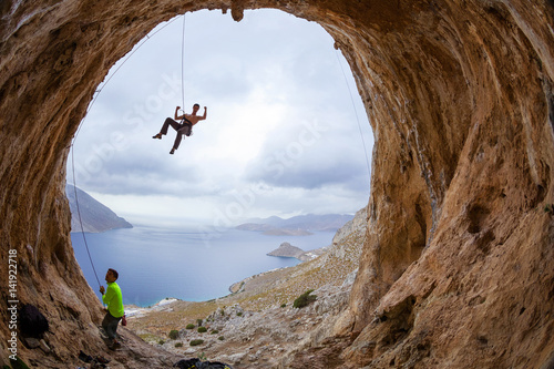 Rock climbers in cave Canvas Print