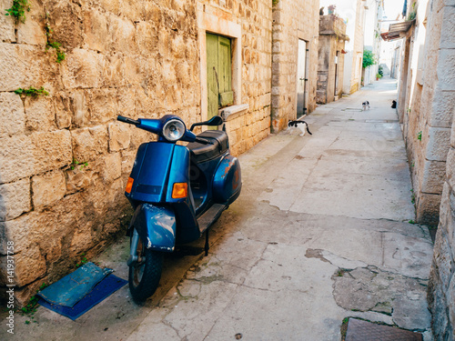 Fototapety, obrazy: Retro Scooter for hipsters on the streets of Croatia and Montenegro. A small malotrade moped.
