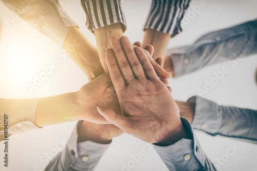 Fotografia  Hands stacked in a pile. A symbol of teamwork and trust.