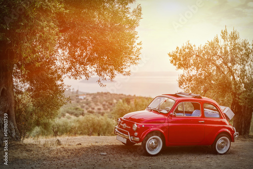 Spoed Foto op Canvas Vintage cars Vintage car and an amazing view