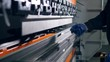 Worker bend metal sheet on a modern bending industrial machine at a factory. 4K.