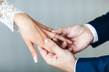 The Hands Of The Newlyweds. A Man's Hand Puts On A Ring. Wedding Ceremony. Bride Hands