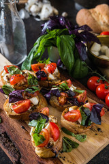 Italian bruschetta with roasted tomatoes and green