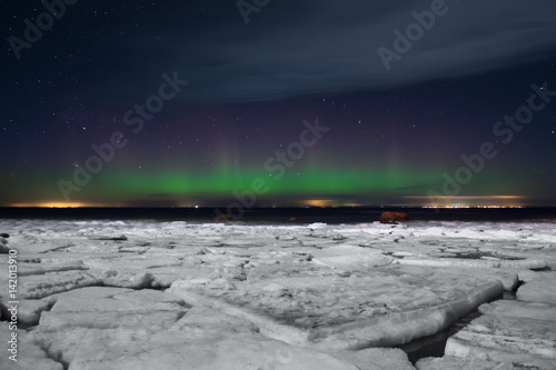 Aurora borealis. Northern Lights. Polar lights and ice floes. Ladoga. Russia St. Petersburg.