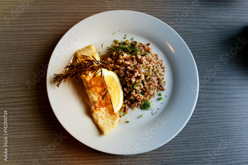 Valokuva  Photo dishes with buckwheat and fish