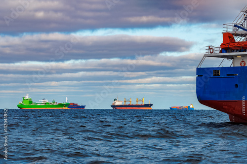cargo ships moored in still baltic sea water buy this stock photo