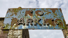 "Rusty Sign: ""No Parking"","