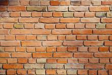 Orange Dirty Brick Wall Background.
