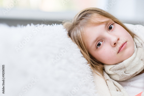 Fotografia  Sick girl with scarf looking at camera