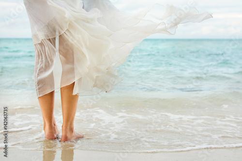White dress waving on seaside wind Slika na platnu