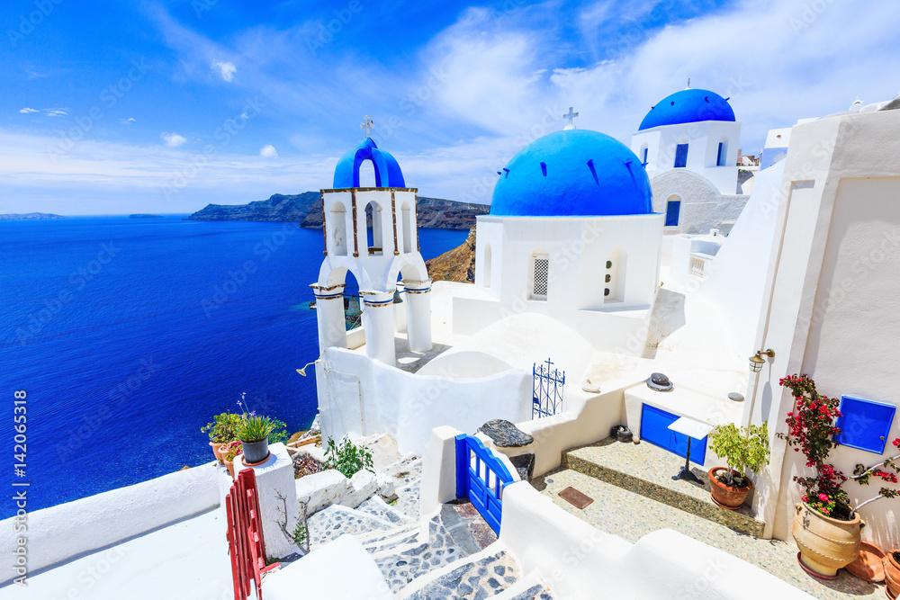Fototapety, obrazy: Santorini, Greece. Blue dome churches of Oia (Ia) village.