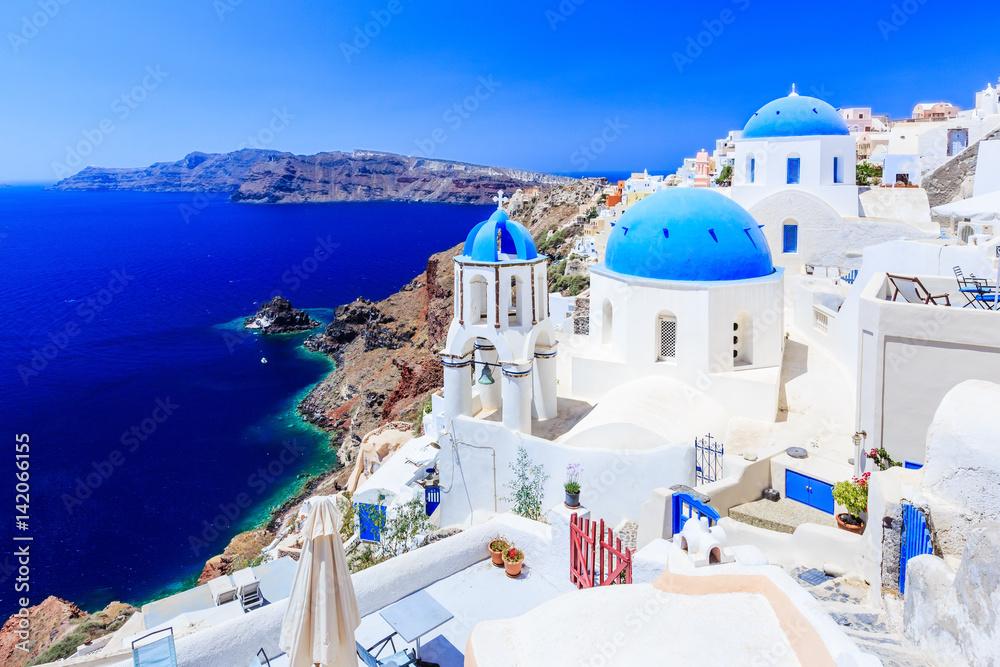 Fototapety, obrazy: Santorini, Greece. Blue dome church on the village of Oia.