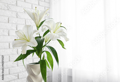 Beautiful white lilies indoors
