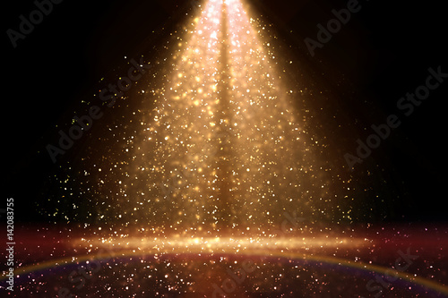 Stage light and golden glitter lights on floor. Abstract gold background for display your product. Spotlight realistic ray