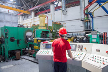 Worker Behind The Dashboard In The Workshop For The Production Of Aluminum Profiles. Aluminum Extrusion Press