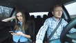 Glamorous crazy couple strongly arguing when riding in the car