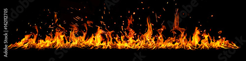 Photo  Fire panorama on a black background.