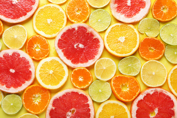 Citrus fruits on a yellow background