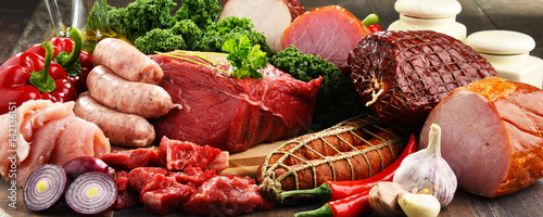 Poster Vlees Variety of meat products including ham and sausages