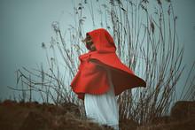 Dark Red Hooded Woman