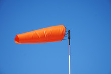 Close Up On Orange Windsock In The Wind