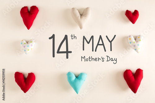 Poster  Mother's Day message with blue heart cushions