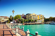 Bridge embankment yacht pier Lake Garda restaurants hotels luxury resort Sirmione Italy