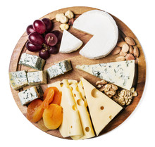 Assortment Of Cheese With Fruits And Grapes Isolated On White Background