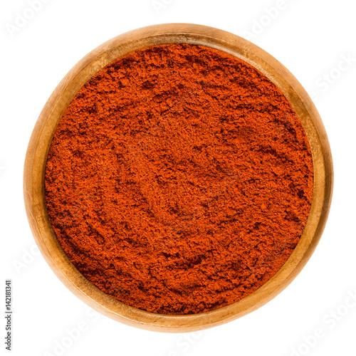 Fotografia, Obraz Sweet pepper red paprika powder in wooden bowl