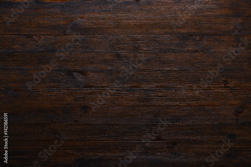 obraz lub plakat Dark wood table texture background top view
