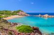 Cala Pregonda beach with golden sand on summer sunny day at Menorca island.