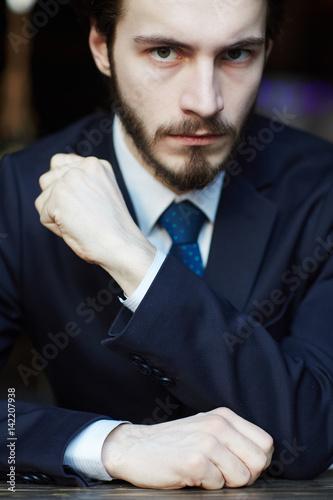Intimidating man in suit sitting