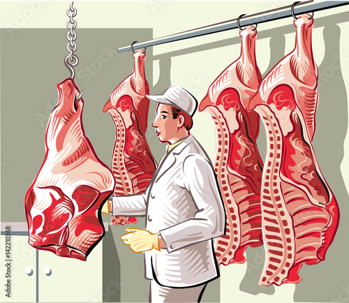 Butcher in a slaughterhouse, divides a side of beef in pieces of meat Canvas Print