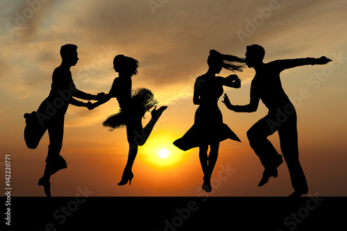 Foto op Canvas Dance School Silhouette couple in the active ballroom dance on sunset