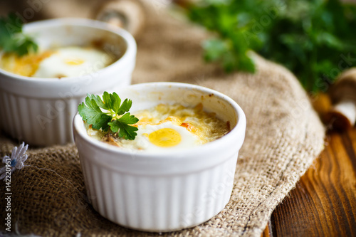 Baked egg with minced fish and mushrooms