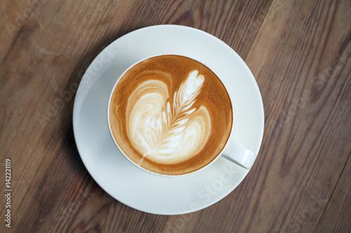 Fotografie, Obraz  latte art coffee on wood background.Vintage Style