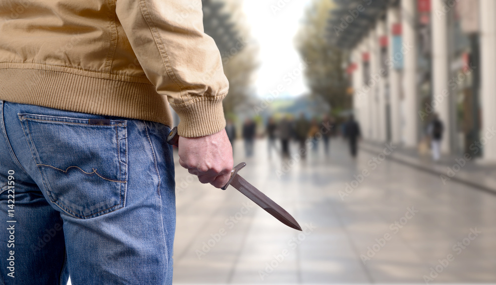 Fototapeta killer attacking with knife on public place