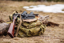 .Set Of Military Hunting Equipment With Rifle In Forest During Hunting Season. Bushcraft, Hunting And Gun Concept