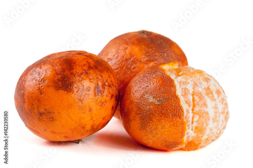 Fototapeta three damaged tangerine isolated on white background