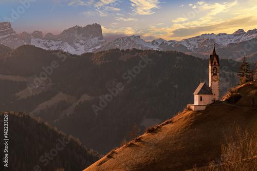 Marron chocolat dolomites mountain church at sunset