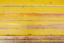 Old Wooden Boards With Peeling Yellow Paint Horizontally
