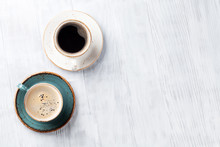 Coffee Cups On Wooden Kitchen Table